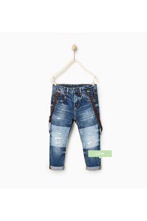 01f4d04b RIPPED JEANS WITH KNEE PATCHES