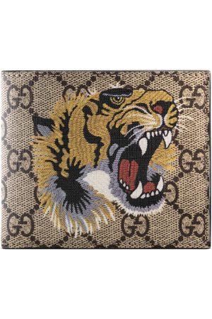 Gucci Tiger print GG Supreme wallet