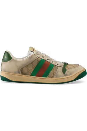 Gucci Distressed GG canvas and leather sneaker