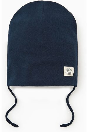 Zara Hat with 'inspire' label
