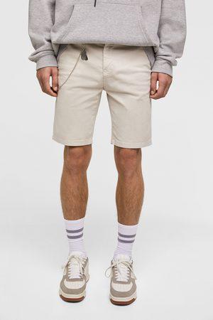 Zara Bermuda shorts with chain