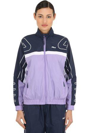 41ca8e8ddfa2 Retro trucker jacket with back logo and shearling collar. Fila Carol Logo  Nylon Track Jacket .