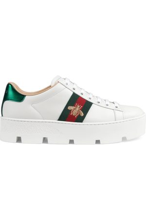 d2eeac0dc81 Gucci Women Trainers - Women s Ace embroidered platform sneaker