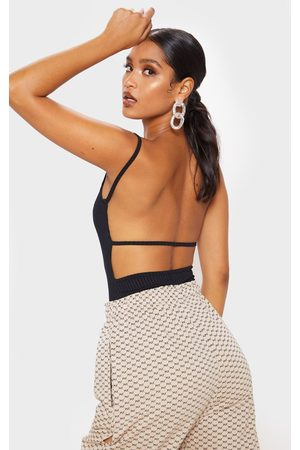 PRETTYLITTLETHING Rib Strappy Back Bodysuit