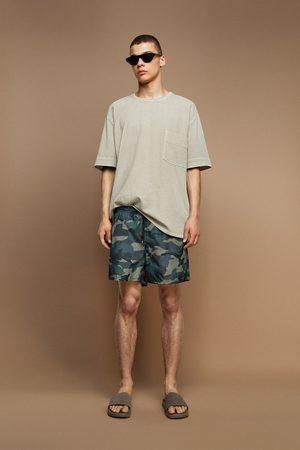 Zara Camouflage print swimming trunks