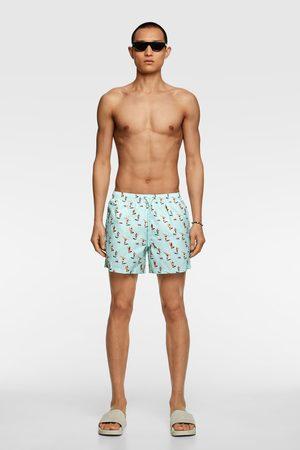 Zara Surfboard print swimming trunks
