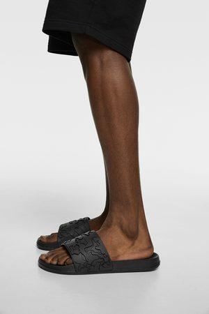 Zara Slide sandals with raised design