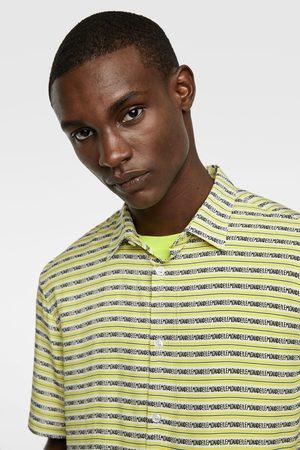 Zara Slogan print shirt
