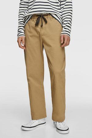 Zara Wide-leg trousers with turn-up hems