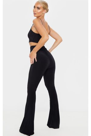 PRETTYLITTLETHING Flare Ruched Bum Slinky Trousers
