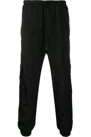 MARCELO BURLON Cross track pants