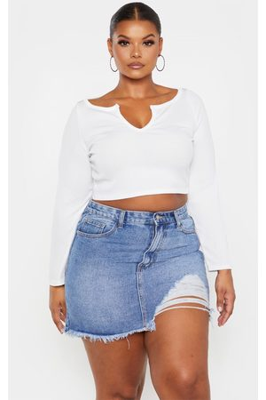 PRETTYLITTLETHING Plus Mid Wash One Sided Distressed Hem Denim Skirt