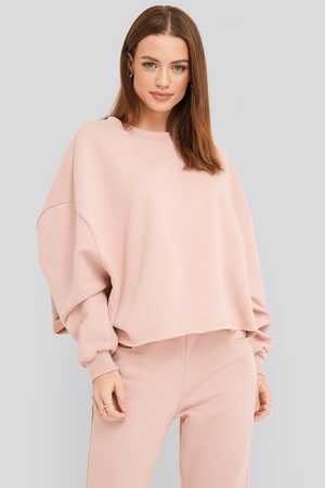 NA-KD Raw Hem Cropped Sweatshirt - Pink