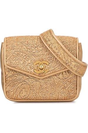 CHANEL Floral-embossed CC turn-lock belt bag