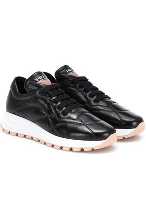 Prada Women Trainers - PRAX-01 leather sneakers