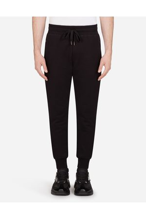 Dolce & Gabbana Trousers and Shorts - JERSEY JOGGING PANTS WITH BRANDED PLATE