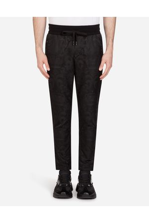 Dolce & Gabbana Trousers and Shorts - JACQUARD JOGGING PANTS WITH PATCH