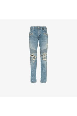 Balmain Distressed tapered slim leg jeans