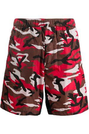 Prada Camouflage print swim shorts