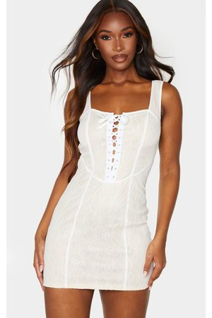 PRETTYLITTLETHING Nude Lace Binded Corset Style Bodycon Dress