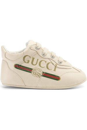 Gucci Baby Trainers - Baby print Rhyton sneaker