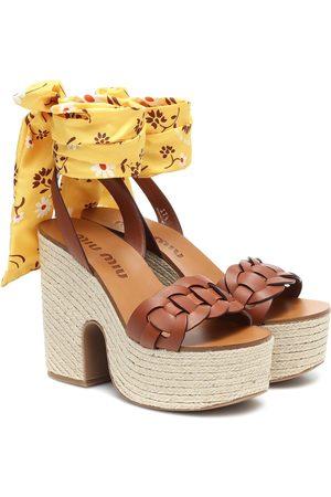 Miu Miu Women Sandals - Leather platform sandals