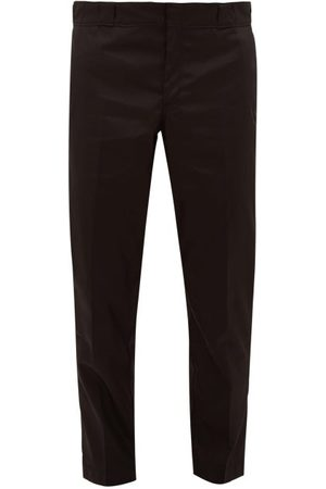 Prada Logo-plaque Nylon-gabardine Trousers - Mens