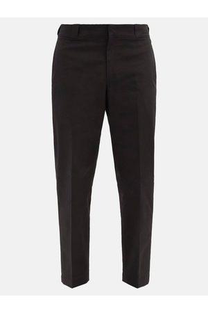 Prada Logo-plaque Nylon-gabardine Trousers - Mens