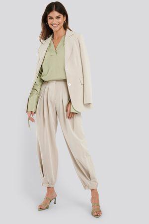 NA-KD Cocoon Elastic Suit Pants - Beige