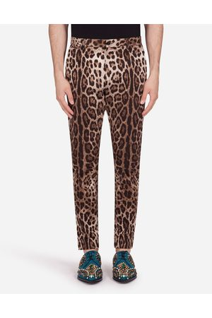 Dolce & Gabbana Men Trousers - Trousers and Shorts - COTTON STRETCH PANTS WITH LEOPARD PRINT
