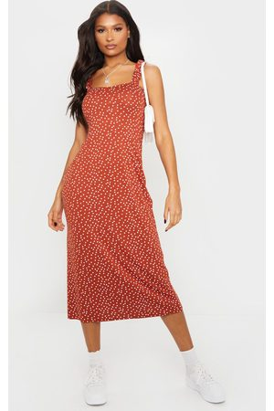 PRETTYLITTLETHING Terracotta Polka Dot Ruffle Strap Midi Dress