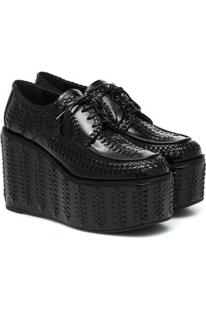 Prada Woven leather platform brogues