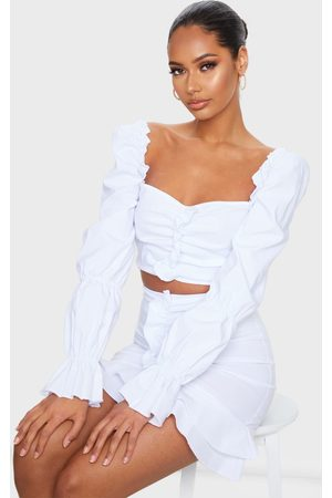 PRETTYLITTLETHING Women Crop Tops - Woven Stretch Frill Ruched Front Long Sleeve Crop Top