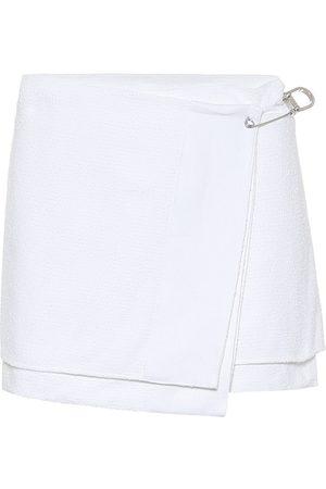 Prada Cotton-blend tweed wrap miniskirt