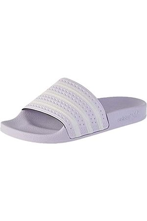 adidas Women's Adilette Slide Sandal, Tint/Footwear / Tint