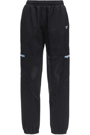 Reebok Tech & Mesh Track Pants