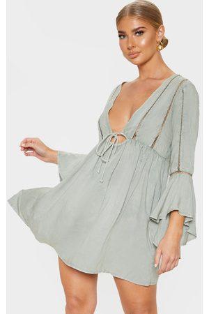 PRETTYLITTLETHING Pale Khaki Tie Front Frill Sleeve Beach Dress