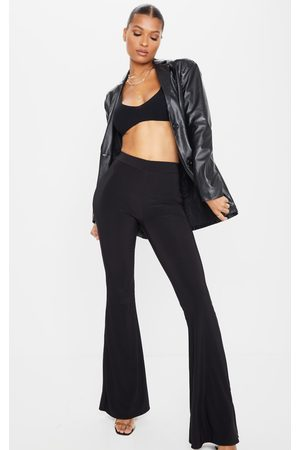 PRETTYLITTLETHING Slinky Flared Trousers
