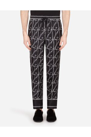 Dolce & Gabbana Trousers and Shorts - SILK PAJAMA PANTS WITH ALL-OVER DG PRINT