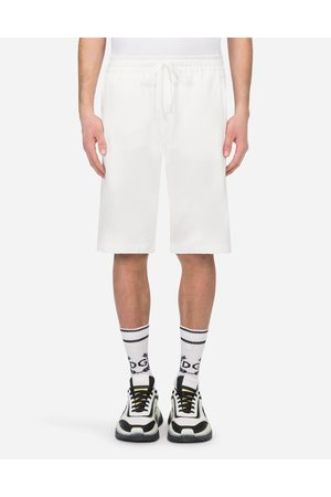 Dolce & Gabbana Men Trousers - Trousers and Shorts - JERSEY JOGGING SHORTS WITH DG LOGO