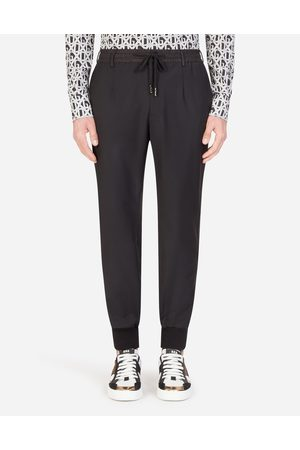Dolce & Gabbana Trousers and Shorts - JOGGING PANTS WITH SIDE STRIPS