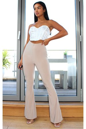 PRETTYLITTLETHING Petite Stone Flare Ruched Bum Slinky Trousers