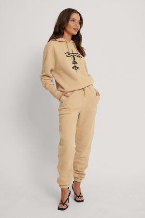 Lisa-Marie Schiffner x NA-KD Organic Drawstring Printed Sweatpants - Beige