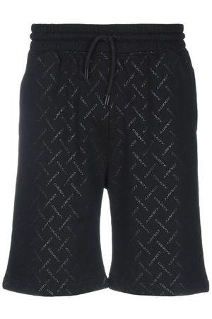 MARCELO BURLON TROUSERS - Bermuda shorts