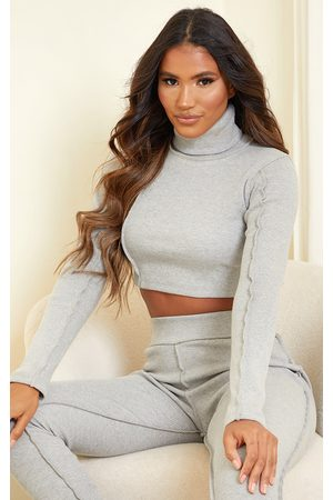 PRETTYLITTLETHING Structured Rib High Neck Stitch Detail Long Sleeve Crop Top