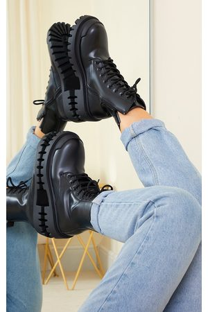PRETTYLITTLETHING PU Lace Up Extreme Cleat Biker Ankle Boots