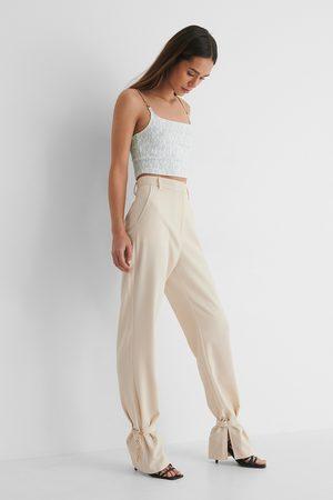 Danaë x NA-KD Chain Detail Suit Pants - Beige