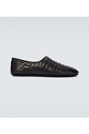 Fendi FF embossed leather slippers
