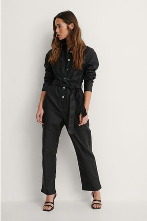 NA-KD Coated Denim Jumpsuit - Black