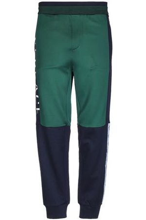 VERSACE TROUSERS - Casual trousers
